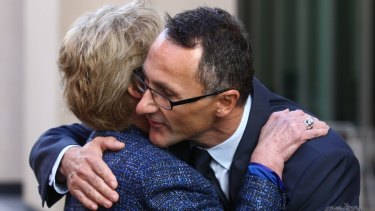 Former Greens leader Senator Christine Milne embraces new Greens leader Senator Richard Di Natale.