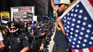 Protestors march through downtown Cleveland on the second day of the RNC.