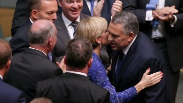 "Business has praised a ""softer, cuddlier budget"" from Treasurer Joe Hockey, seen here congratulated by Foreign Affairs Minister Julie Bishop after handing down the Budget, but foreign aid recipients will suffer."