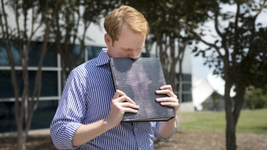 WDBJ7 news anchor Chris Hurst is overcome with emotion while holding a photo album created by his fellow reporter and girlfriend Alison Parker.