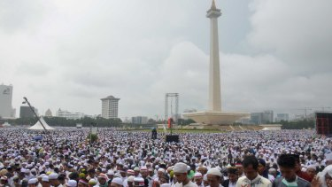 Tens of thousands take part in a prayer at Jakarta's National Monument during the December 2 rally against Ahok.