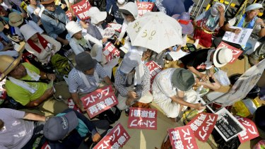 Protesters stage a rally near the gate of the Sendai Nuclear Power Station.