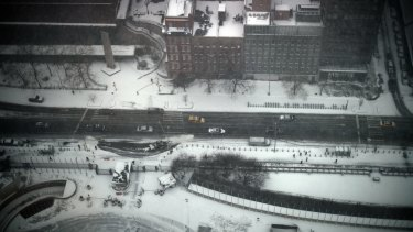 View from above: The streets empty of traffic as the storm bears down.