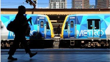 Metro trains and Flinders St rail station.