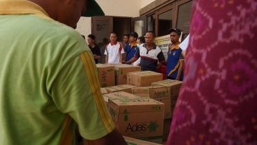 Members of the Taskforce unload water for evacuees at Tanah Ampo Post Command in Bali