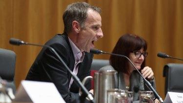 Senator Nick McKim argues with committee chair senator Ian Macdonald.
