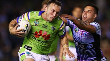 Josh Hodgson of the Raiders runs the ball.