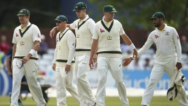 Leading from the front: David Warner, with Shane Watson, Mitch Marsh, Peter Siddle and Fawad Ahmed celebrate after bowling out Derbyshire during day three.