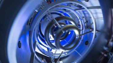 The magnetic coils inside the compact fusion experiment are critical to plasma containment.