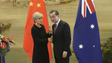 Australian Foreign Affairs Minister Julie Bishop shakes hands with Chinese Foreign Minister Wang Yi in Beijing on February 17. The South China Sea was one topic they discussed.