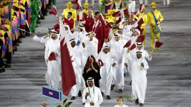 Qatar's flag bearer Sheikh Ali al-Thani leads his team of imports during the Rio 2016 Opening Ceremony on Friday.