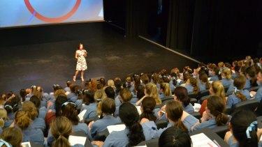 Nicole Pedersen-McKinnon presenting to high school students.