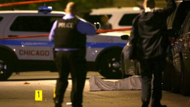 Police at the scene of a shooting in Chicago's Washington Park neighbourhood in June.