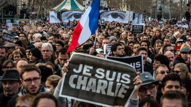 Demonstrators make their way along Place de la Republique in Paris after the terrorist attacks on the Charlie Hebdo satirical newspaper in January 2015.