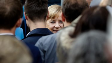 German Chancellor and Chairwoman of the Christian Democratic Union party (CDU), Angela Merkel, centre, arrives for an election campaign rally in Regensburg, Germany, on Monday.