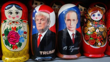 Traditional Russian wooden dolls depicting US President Donald Trump and Russian President Vladimir Putin.