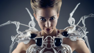 The Spider Dress 2.0, by Anouk Wipprecht, raises its arms to 'attack' if a stranger gets too close.