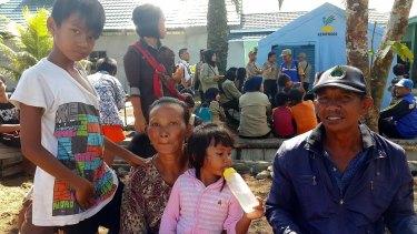 Former Gafatar members Supriyadi, right, his wife Nurul, their youngest daughter Dewi Suci and  son Waliandi.