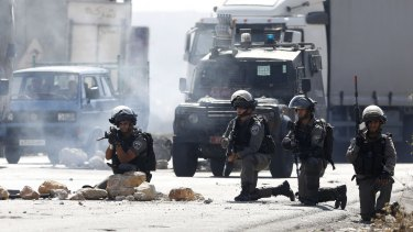 Israeli border policemen take positions during clashes with Palestinians at the Hawara checkpoint, near the occupied West Bank city of Nablus.