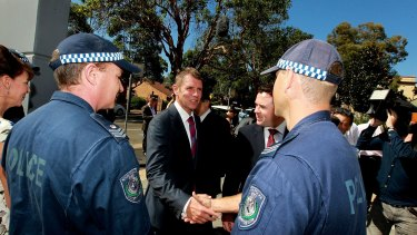 'We are coming after you': NSW Premier Mike Baird was at Granville police station to announce tough new rules to combat organised crime.