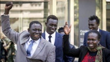 "Majak Daw outside court with his father William and mother Elizabeth. William Daw crossed himself and cried ""hallelujah"" as he led his son out of the court building."