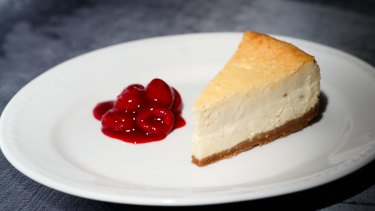 Cheesecake with poached raspberries.