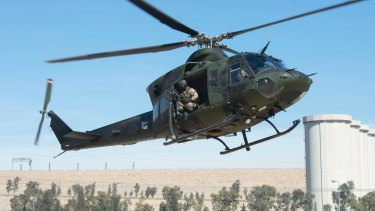 A Canadian Forces Griffon helicopter comes in for a landing near the Mosul dam in February.