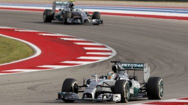 A one-two finish: Lewis Hamilton leads teammate Nico Rosberg during the US Grand Prix.