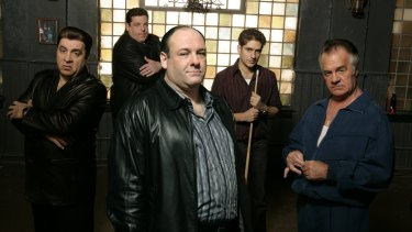 The cast of The Sopranos, including James Gandolfini (centre), backstage at the Bada Bing!
