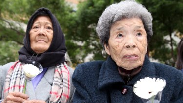 Former comfort women, Estelita Dy (left), from the Philippines, and Cheng Chen-tao from Taiwan, in Taiwan earlier this month.
