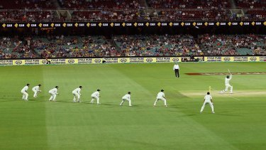 Tense finish: New Zealand stacked the cordon in the closing stages of Australia's chase.