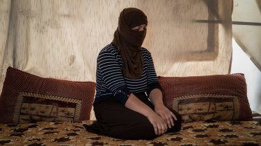 A Yazidi woman who had been held by Islamic State militants as a slave for several months sits in a tent outside Duhok, Iraq.