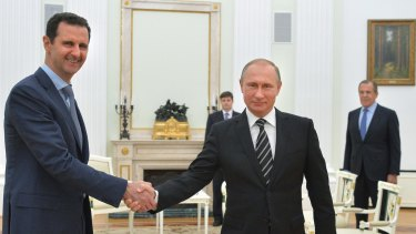 Russian President Vladimir Putin shakes hand with Syrian President Bashar Assad in Moscow in October 2015.
