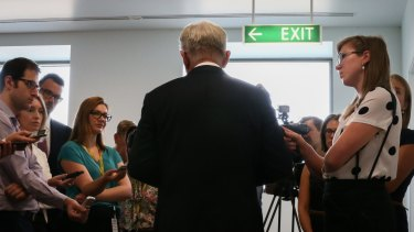 Trade Minister Andrew Robb addresses the media during a doorstop interview at the Press Gallery in Parliament House.