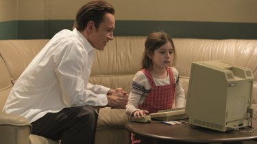 Michael Fassbender as Steve Jobs with his daughter.