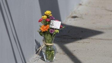 A makeshift memorial near the police perimeter of the mass shooting in San Bernardino.