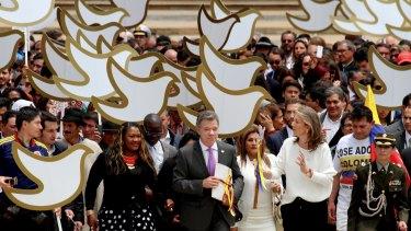 Colombian President Juan Manuel Santos delivers the original peace deal to Congress.