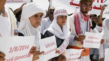 Yazidi Kurdish women at a protest in Dohuk, Iraq, in 2015.