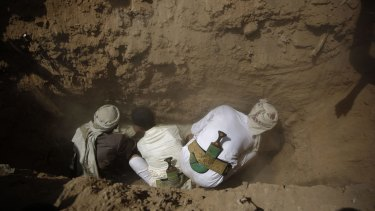 Shiite Houthis rebels bury one of their comrades, killed in a suicide bomb attack by Sunni Islamist militants.