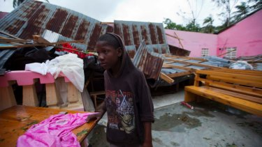 A boy stands in a church after it was damaged by Hurricane Matthew in Saint-Louis, Haiti, on Wednesday.