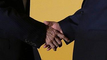 Handshake: Taiwan's President Ma Ying-jeou (left) and Chinese President Xi Jinping.