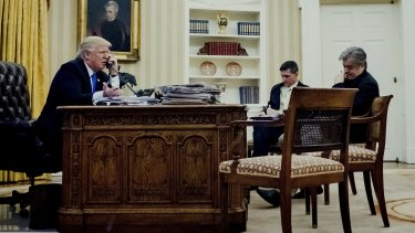 Mr Trump's national security adviser Michael Flynn, cenre, and chief strategist Steve Bannon listen in on the President's phone call with Mr Turnbull.