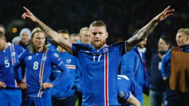 Iceland's captain Aron Gunnarsson celebrates his country's World Cup qualification, leading the 'Viking Clap'.
