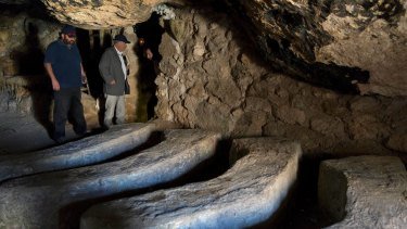 Yehuda Shaul, left, co-founder of Israeli group Breaking The Silence, and Colm Toibin inspect a cave where 34-year-old Palestinian Nasser Nawaja said he was born.