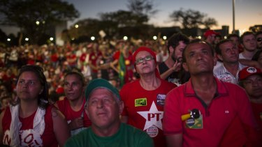 Government supporters in Brasilia watch on a large screen as legislators  vote on whether or not to impeach President Dilma Rousseff.