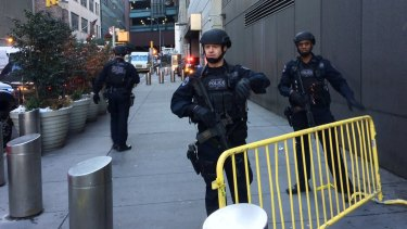 Police block off a footpath while responding to a report of an explosion near Times Square.