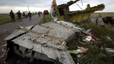 Locals gather near part of the MH17 wreckage near the settlement of Grabovo.