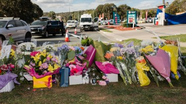 Flowers on Saturday at the scene of the fatal stabbing at the Queanbeyan Caltex service station.