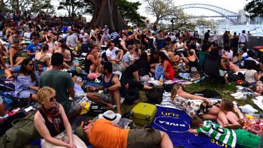 Crowds build as they wait for New Year's Eve fireworks on Sydney Harbour.