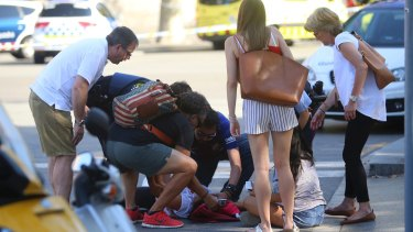 A person is treated in Barcelona after the van attack.
